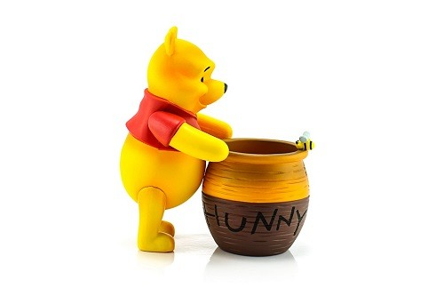 Figure of Winnie the Pooh and his hunny pot