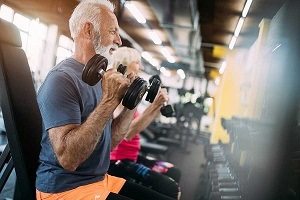 Man and Woman exercising in Gym