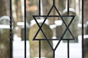 Star of David at the entrance of a jewish cemetery in winter.