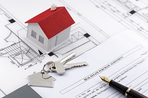 Real estate sale paperwork and Housing Model with Architectural blueprints