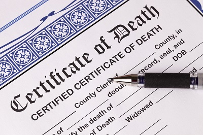Death Certificate with pen. Close-up of top of certificate