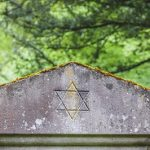 Star of David on an old headstone in an ancient jewish cemetery.