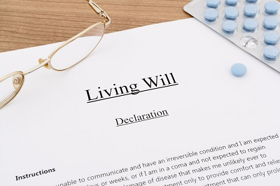 living will with pills and eyeglasses